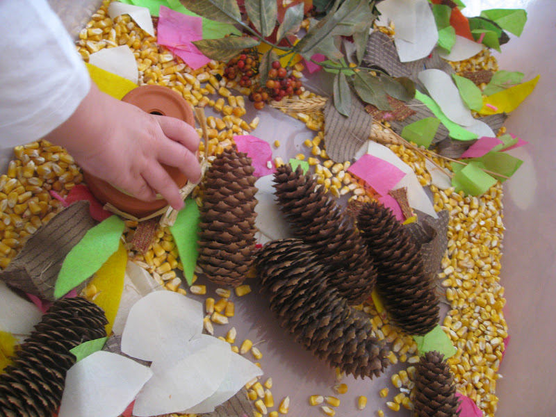 Thanksgiving sensory bin to manipulate and build fine motor skills.