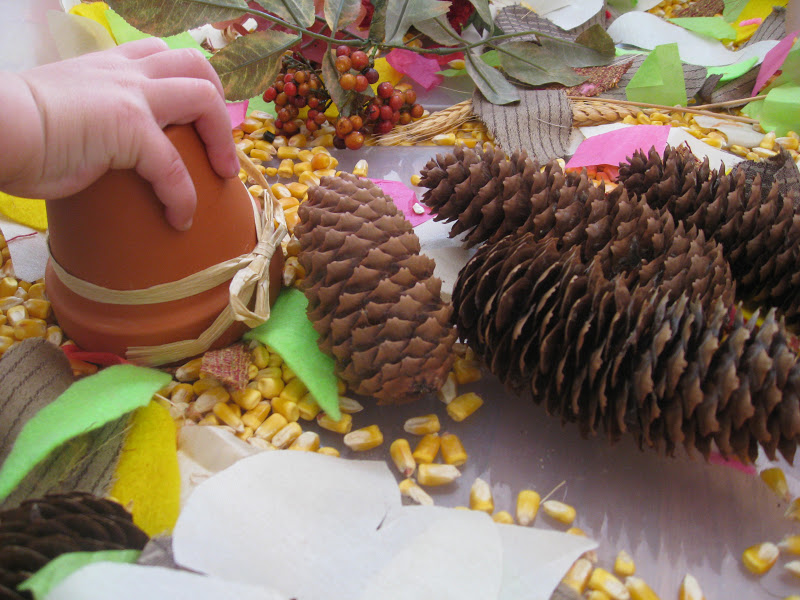 Thanksgiving sensory ideas for sensory play and exploration, using many Fall materials.