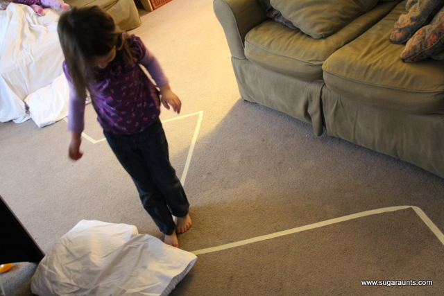Challenge kids in a masking tape obstacle course with a polar bear theme.