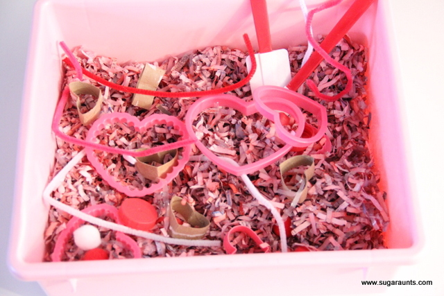 Use colored shredded paper in a Valentines sensory bin.