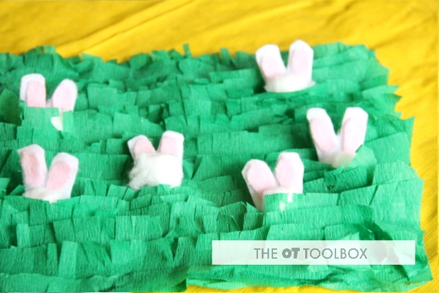 Easter play ideas using a DIY sensory mat and cotton ball bunny crafts for kids to use in fine motor work.