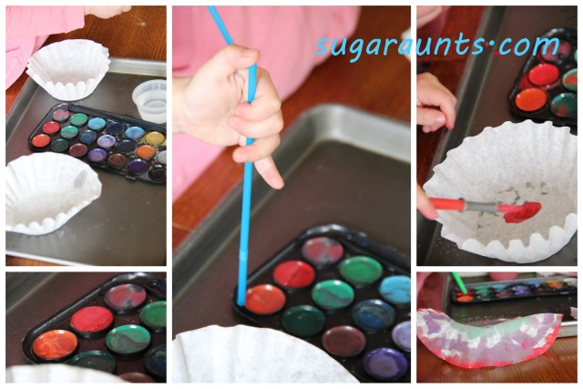 Make a coffee filter craft and build fine motor skills with kids using a straw to paint.