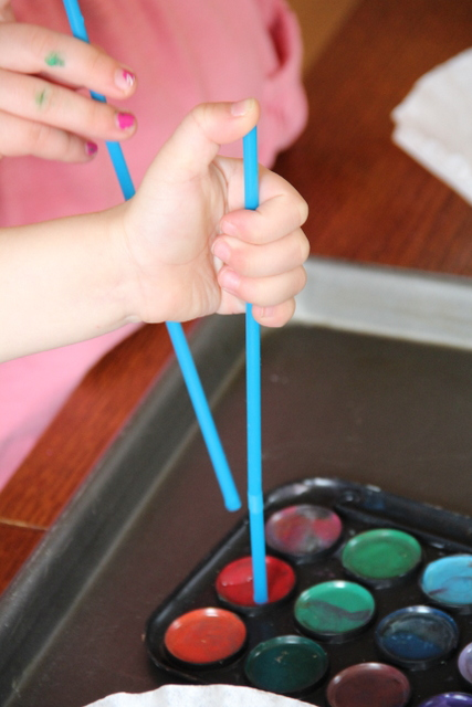 Use straws to paint with watercolors and work on fine motor skills with kids.