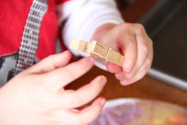 Work on fine motor strength with clothes pins to make a butterfly coffee filter craft.
