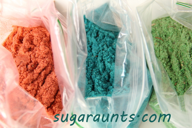 add food coloring to baggies of sand