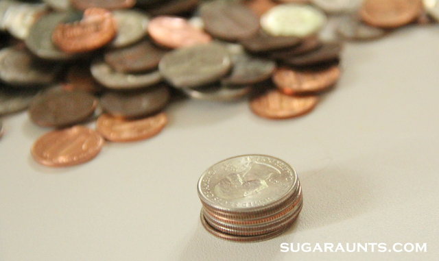 Stack coins for a fine motor workout and to improve coin sorting skills.