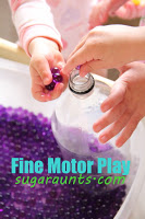 Work on fine motor skills by playing with waterbeads