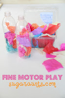 Fine motor play using tissue paper