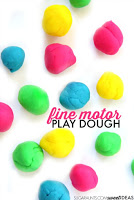 Help kids with fine motor skills using small balls of play dough.