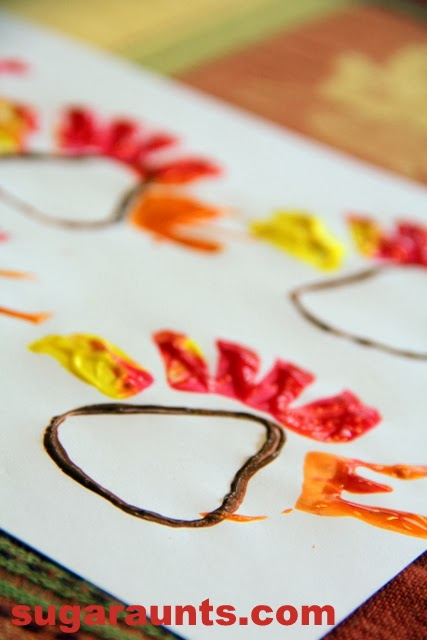 How cute is this turkey art? Use a toilet paper tube to make this turkey painting craft for kids.