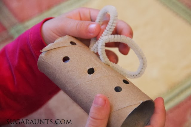 This turkey napkin ring craft is a great way for kids to develop fine motor skills.