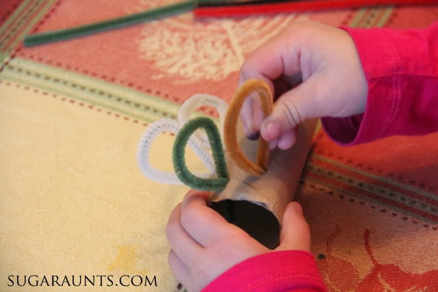 Kids can make this turkey napkin ring craft with a cardboard tube and pipe cleaners.