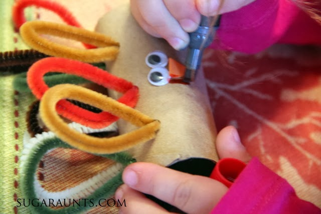 Turkey craft for kids turns into a turkey napkin ring for the dinner table.