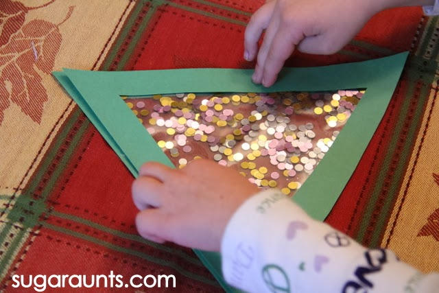 Kid craft for Christmas activities that builds fine motor skills.