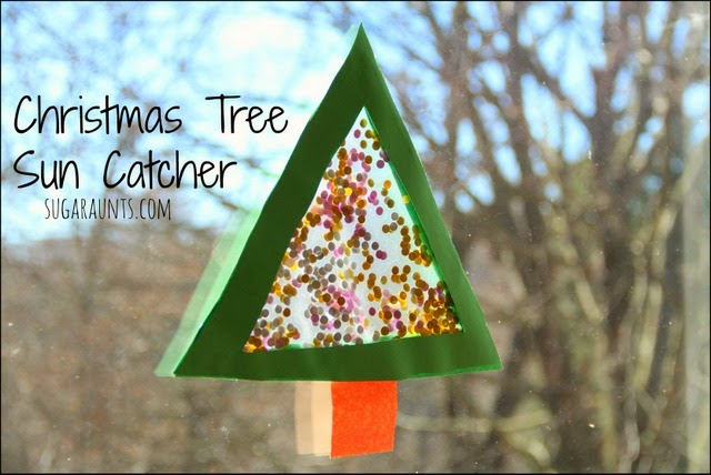 Such a cute Christmas suncatcher craft for kids.