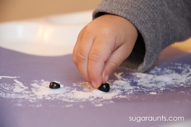 Fine motor snowman craft with glitter paint.