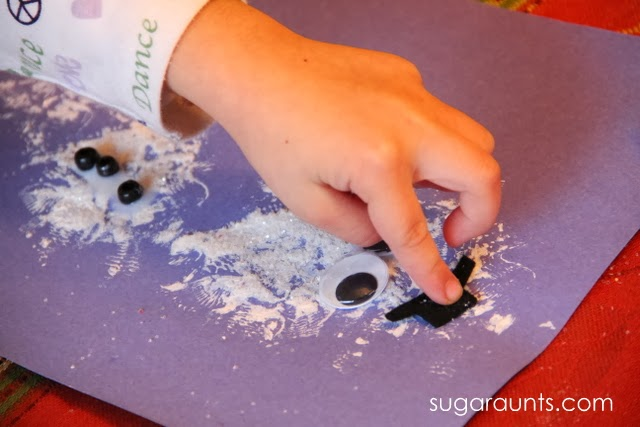 Fine motor snowman craft with homemade glitter paint.