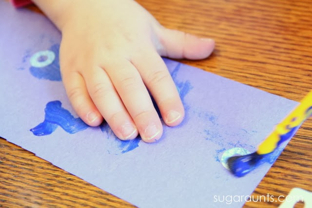Paint hole reinforcement stickers to make a snowan.