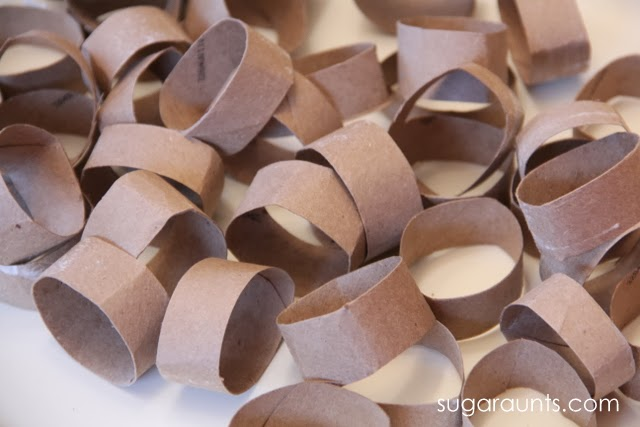 Kids will love to make these Olympic Rings craft while watching the Olympic Summer Games this year! Perfect for the winter games, too! Uses recycled toilet paper tubes for a 3D craft.