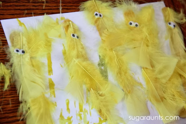 Feathers and popsicle sticks make a fun chick puppet craft for kids