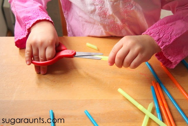Kids can work on scissor skills by cutting straws into small pieces.
