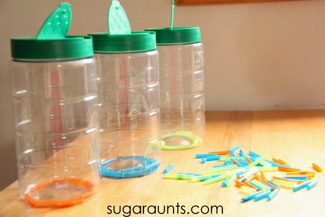 Cut straw into small pieces and provide three recycled containers to sort and work on fine motor skills with kids.