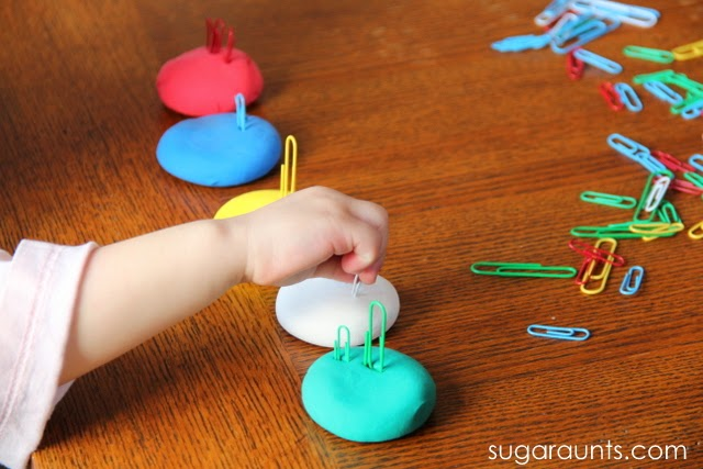 Kids can work on many fine motor skills with play dough and paper clips.