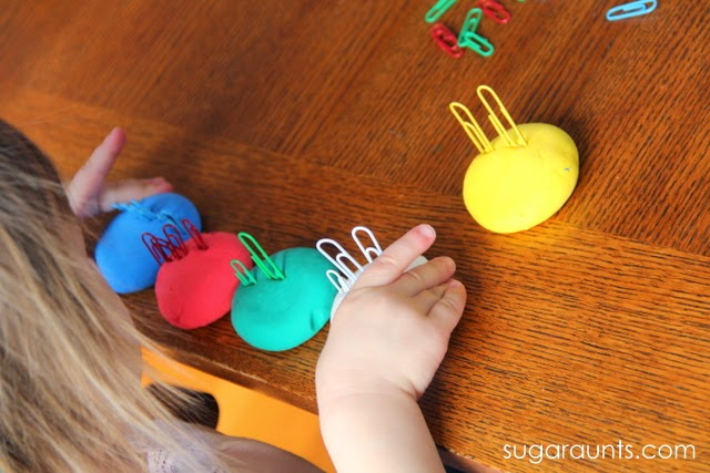 Toddlers can work on fine motor skills with play dough.