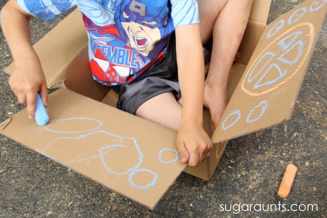 Use chalk to draw on cardboard.