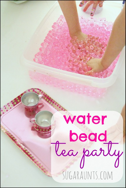 Set up an invitation to play with the kids. Imagination, fine motor, pretend, and more with water beads!