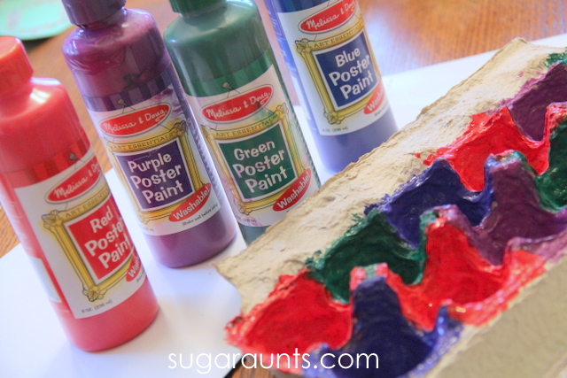 Paint the egg carton to match the jingle bells kids will use to work on color sorting, counting, and fine motor skills.