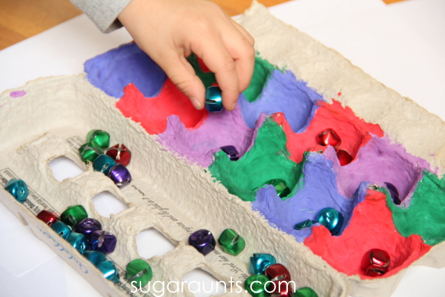 Kids can work on fine motor skills with this Jingle bell activity.