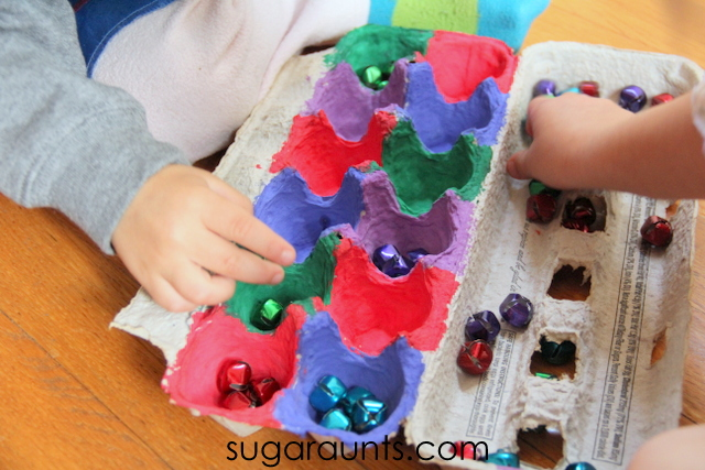 Preschool jingle bell activity to work on fine motor skills, color sorting, counting.