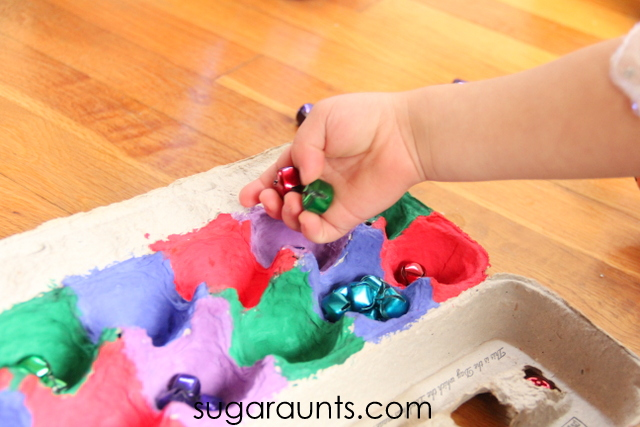 This jingle bell activity works on fine motor skills like in hand manipulation.