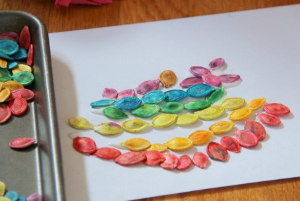 Colored pumpkin seeds can be used in Fall sensory play and fine motor crafts.