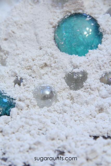 Fake snow dough recipe and use glass gems for fine motor skills.