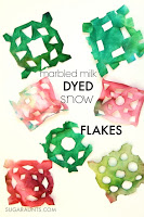 marbled milk snowflakes.  These brightly colored snowflakes are dyed with marbled milk!