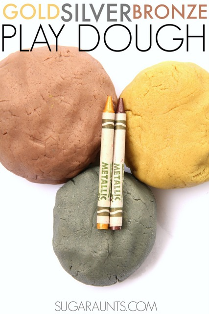 Gold, silver, and bronze play dough with sparkles! Made from metallic crayons.