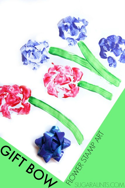 Make flower art using a gift bow to stamp! Cute idea for a flower craft or DIY wrapping paper.