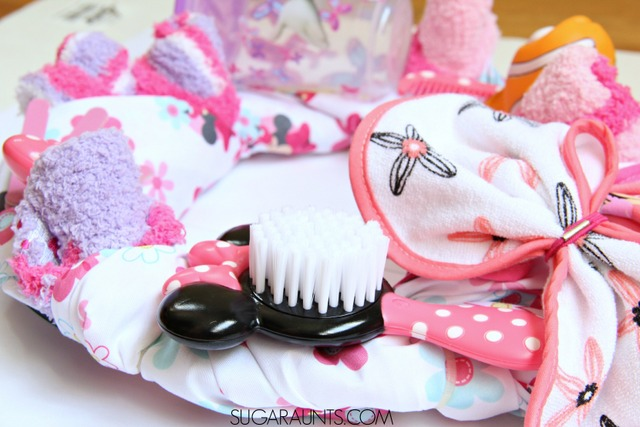 Make a New baby Wreath using a fitted sheet and baby items!  This is perfect for a baby shower gift idea or gift for a second or third baby. #MagicBabyMoments #ad @walmart