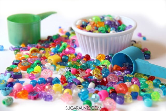 Use beads, scoops, spoons, and bowls to work on scooping for toddlers, preschoolers, and kindergarten to develop fine motor skills.