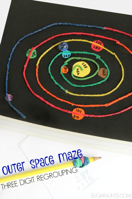Practice regrouping three digit numbers with this 3D Outer Space math maze that kids can use for extra practice and with bilateral hand coordination.