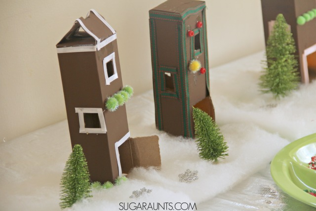 Throw a Cookie Decorating Party or play date this Christmas season.  I love the cookie box gingerbread village at this kid-friendly party!