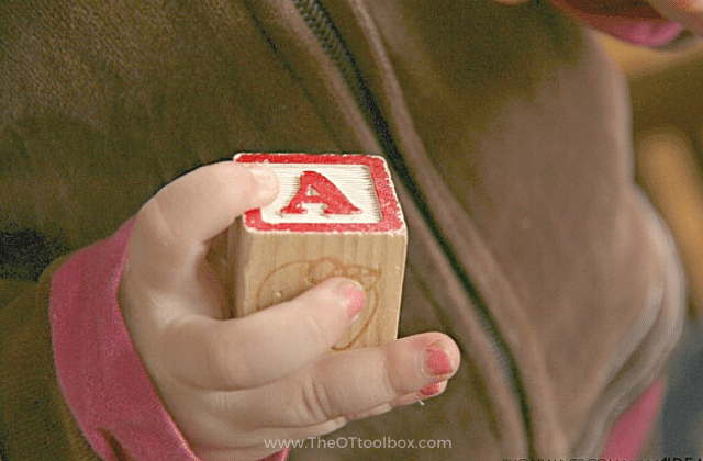Babies can develop the fine motor skill of a Radial palmer grasp with a wooden block
