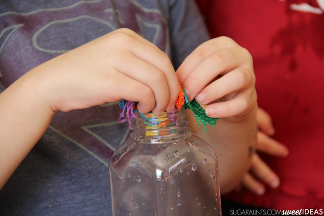 Friendship activity with a rainbow sensory bottle.