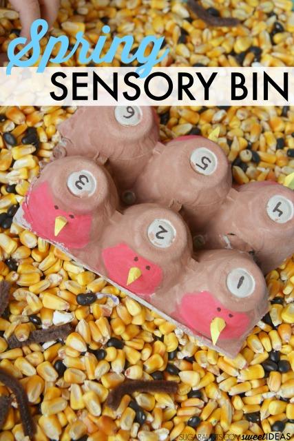 Kids will love this Spring robin sensory bin with corn filler.