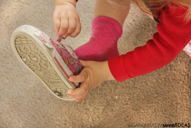 Fine motor skills needed for independence with dressing. Kids and parents will like these ideas to build independence. Part of the Functional Skills for kids series by Occupational Therapy and Physical Therapy bloggers.