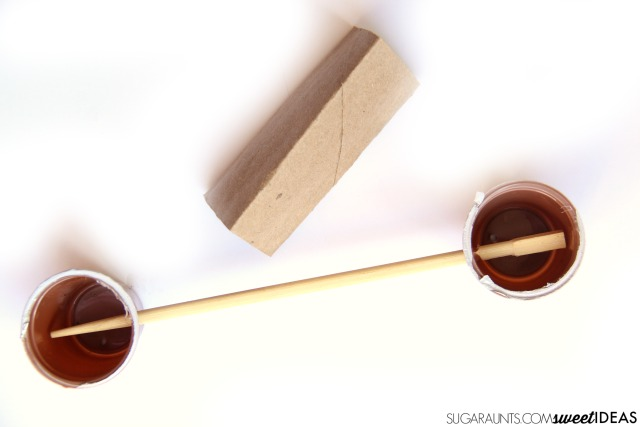 Build a lever and fulcrum with recycled materials in this STEM activity that is perfect for kids to do over the summer at home or at summer camp to prevent the summer slide!