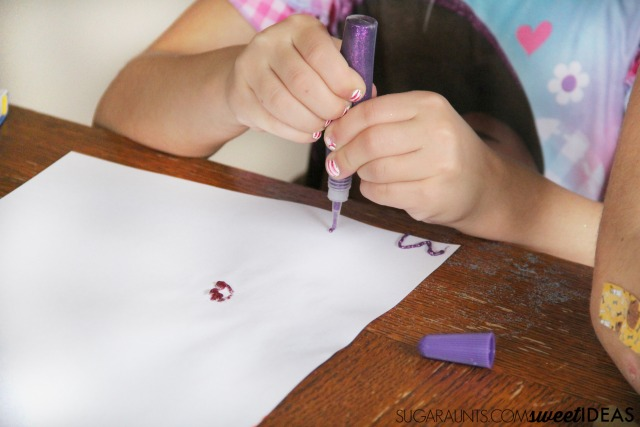 Use glitter glue to make creative lacing cards and fine motor skills development.