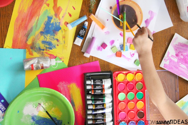 Use art supplies to make your own lacing cards and address fine motor skills.